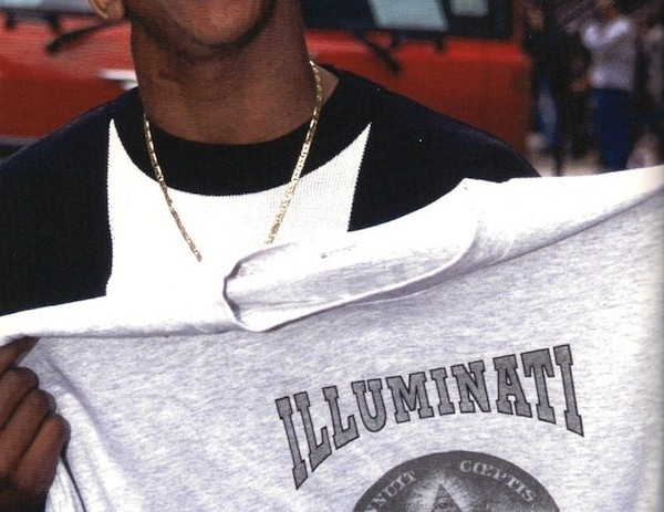 Craig Mack Holding A T-Shirt That Says &#8220;Illuminati 2010&#8243; in 1996